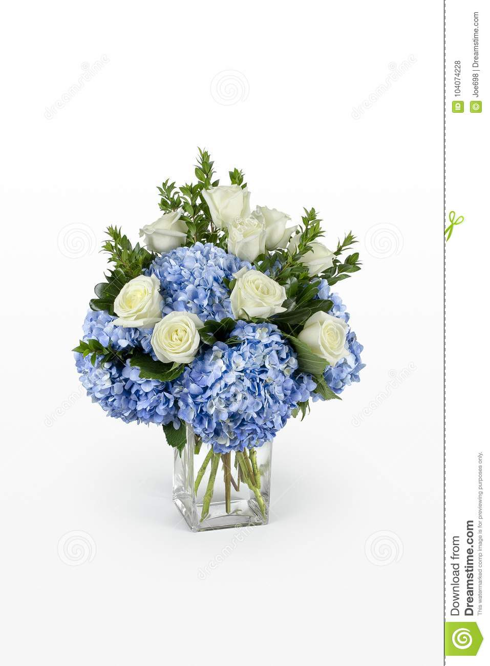Blue Hydrangea And White Roses Flower Arrangement In A Large Glass