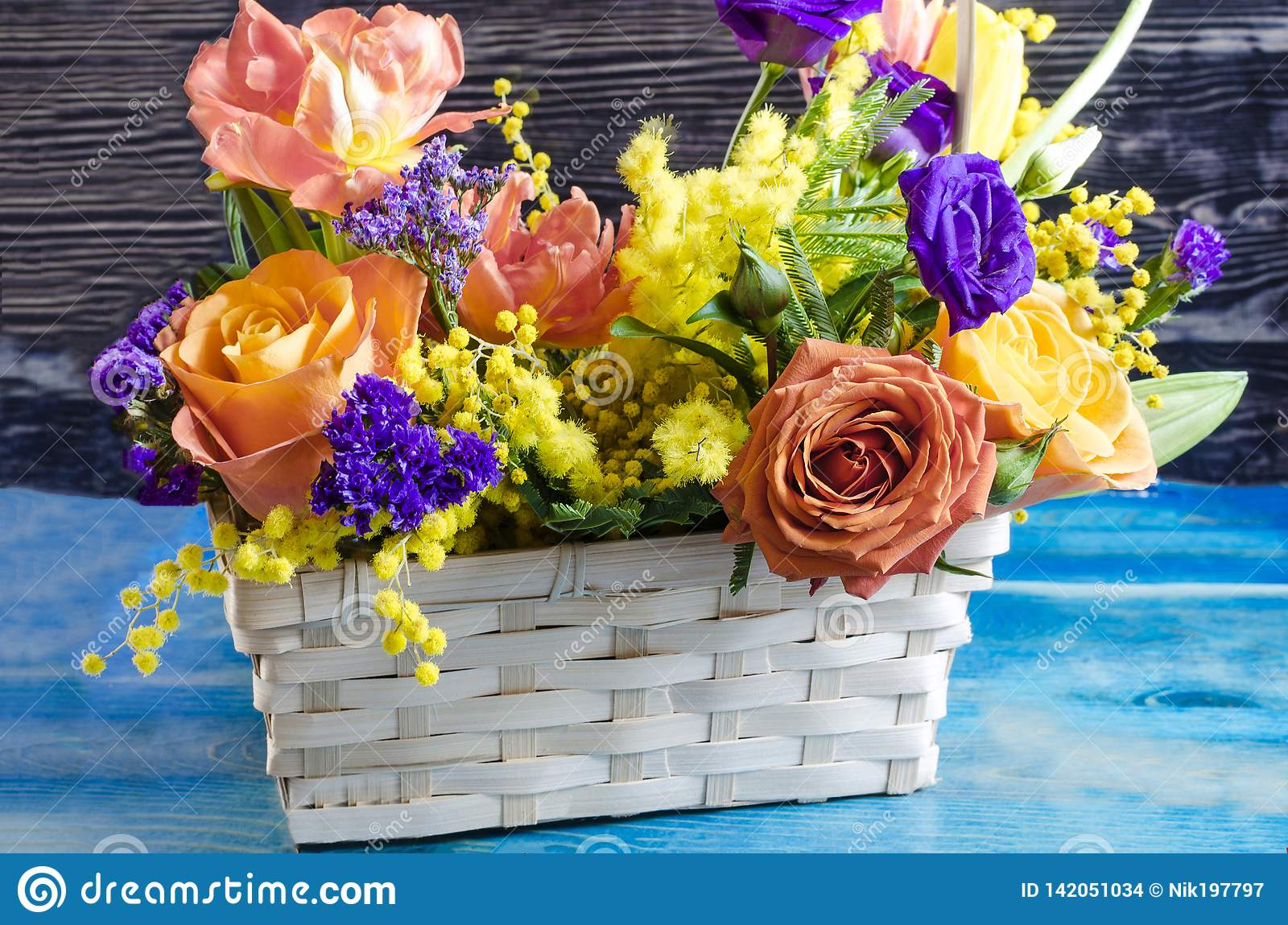 Flower Arrangement Close Up Of Fresh Flowers Of Red Yellow Blue Orange Flowers In A Wicker Basket Stock Photo Image Of Petals Arrangement 142051034