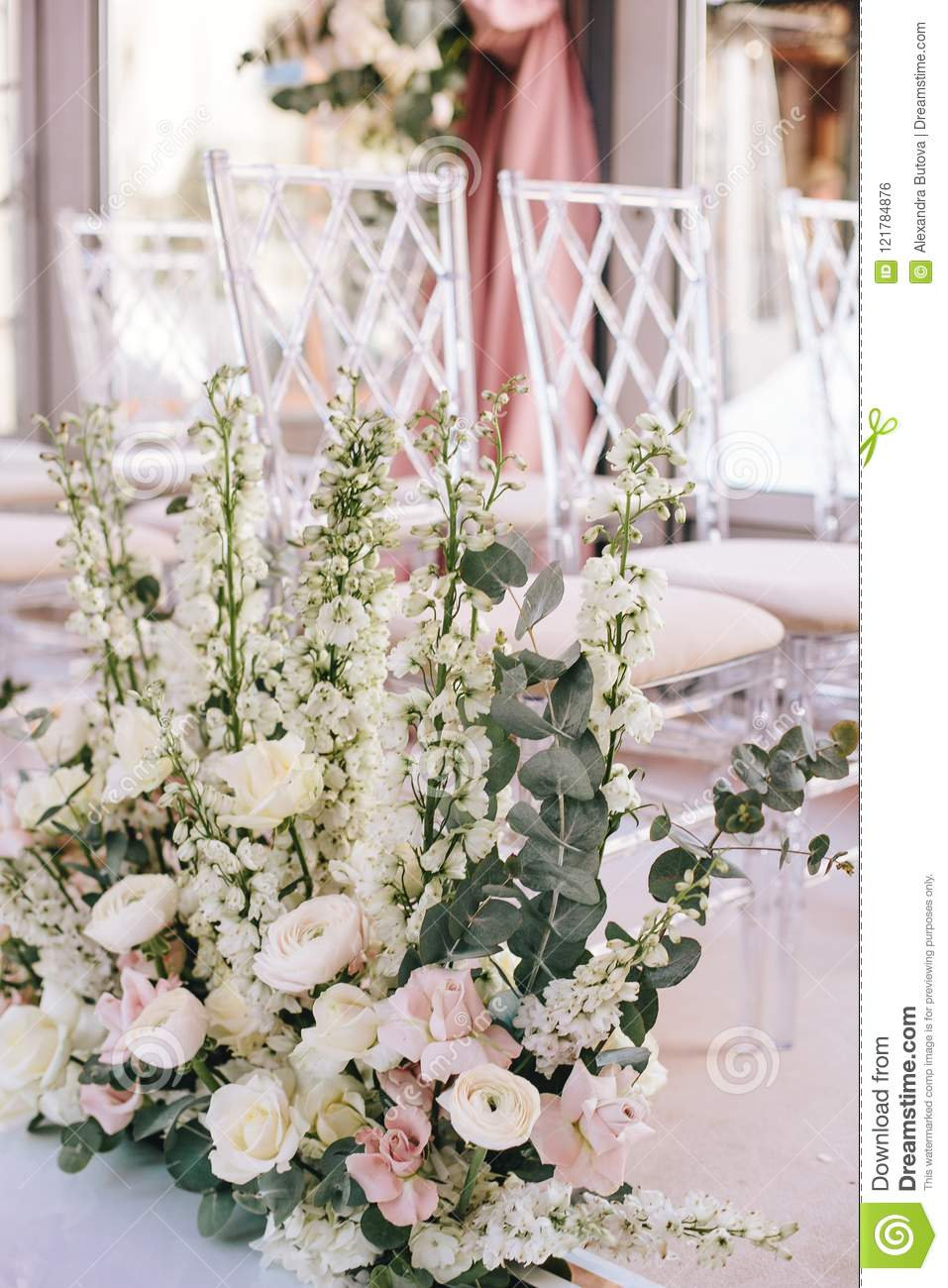 Flower Arrangement Of Pink Roses Buttercups And White Bells And