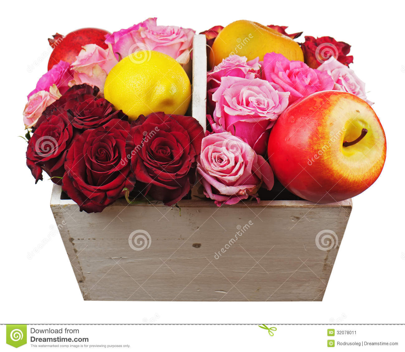 Flower arrangement of red roses and fruits in wooden basket isolated on white background.