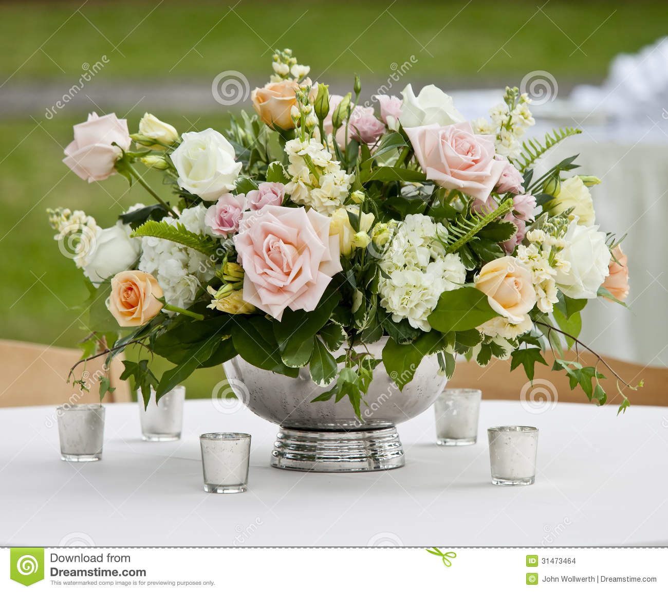 Stock Images: Flower arrangement in silver bowl