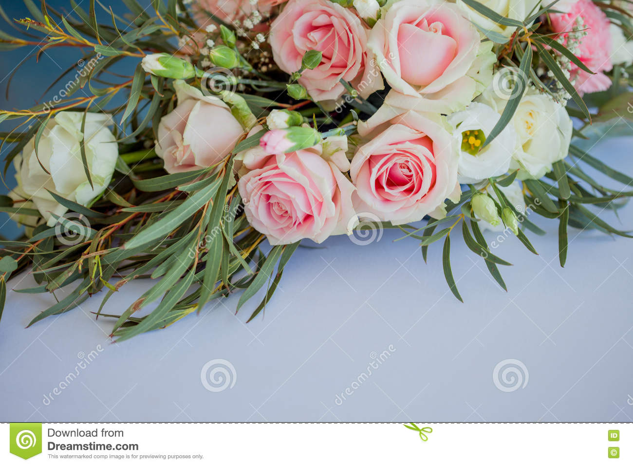 Flower Arrangement On The Table Flowers And White Tablecloth