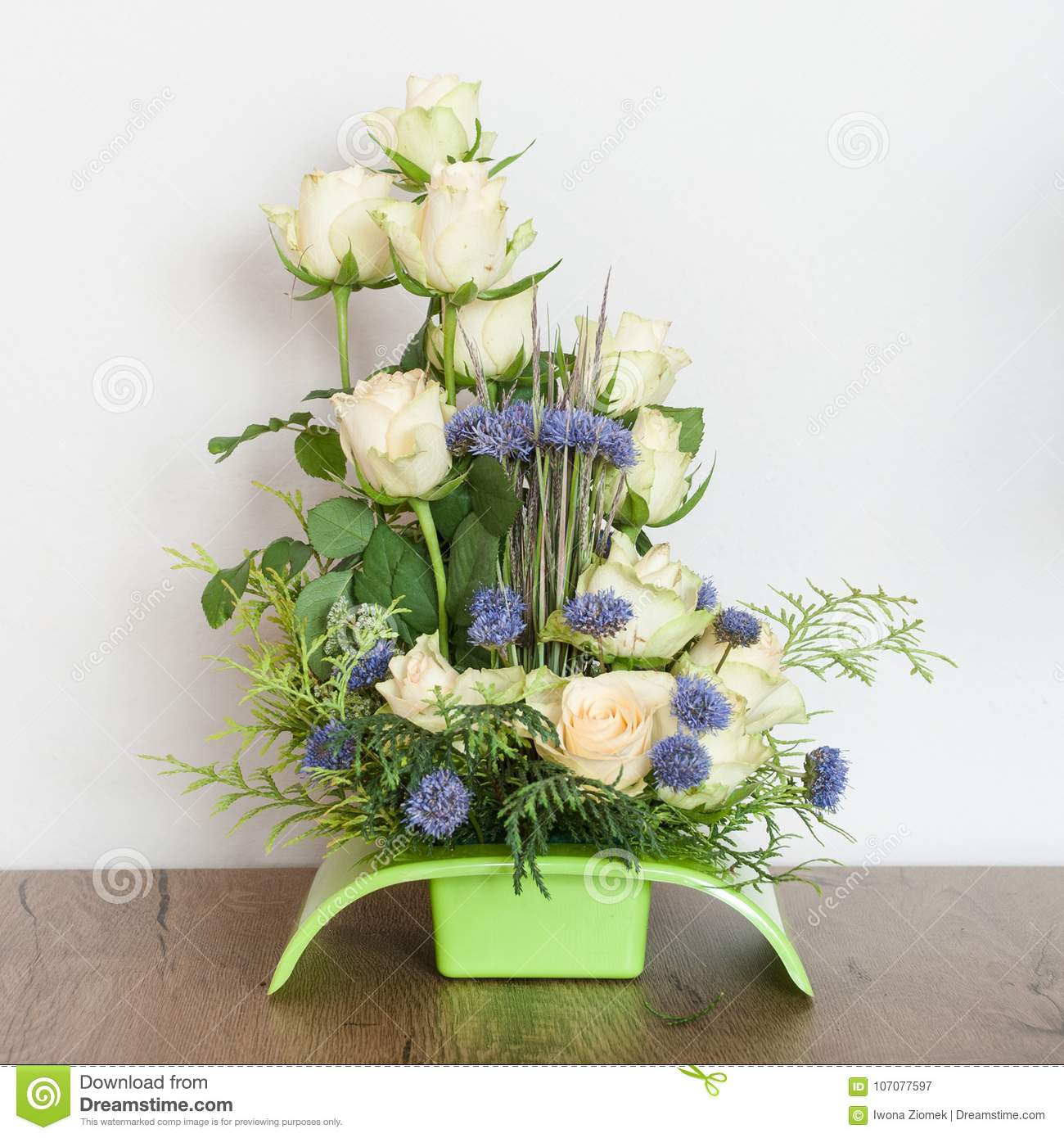 Flower arrangement of white roses with the addition of field blue flowers 653f0a63abf