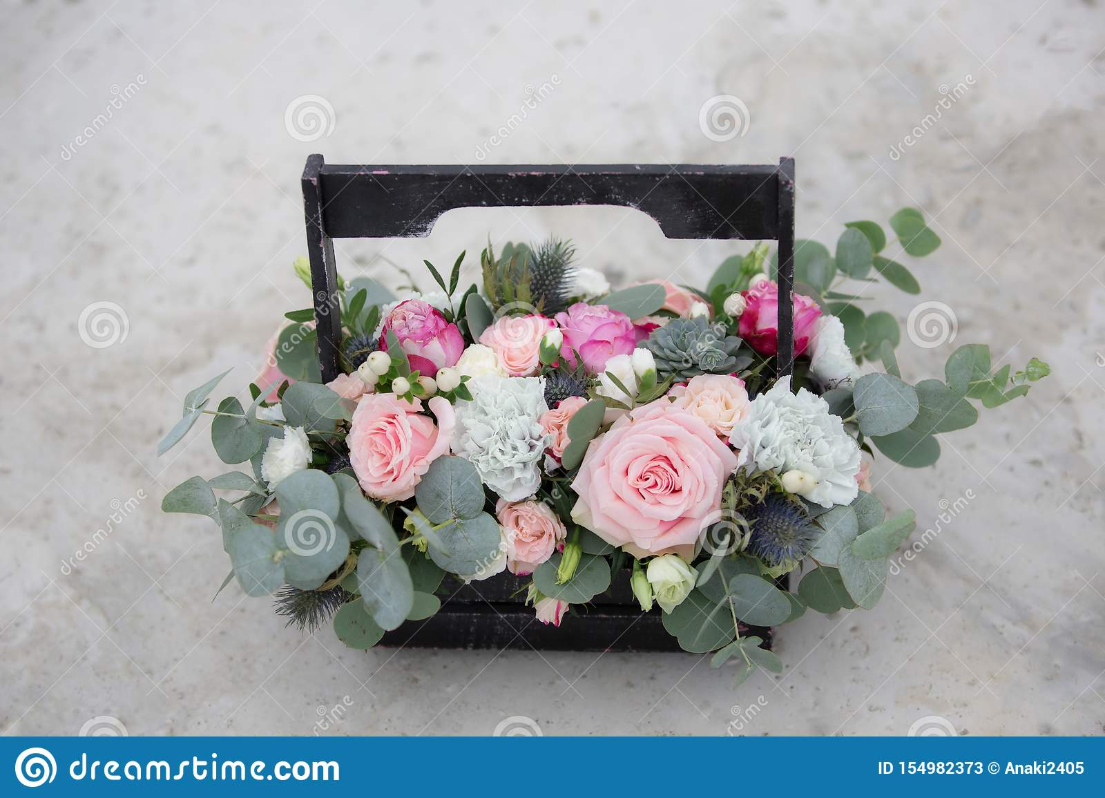 Flower Arrangement In A Wooden Box With Spray Pink Roses Succulent Eustoma White Hypericum Eucaliptus Stock Image Image Of Celebration Decorative 154982373