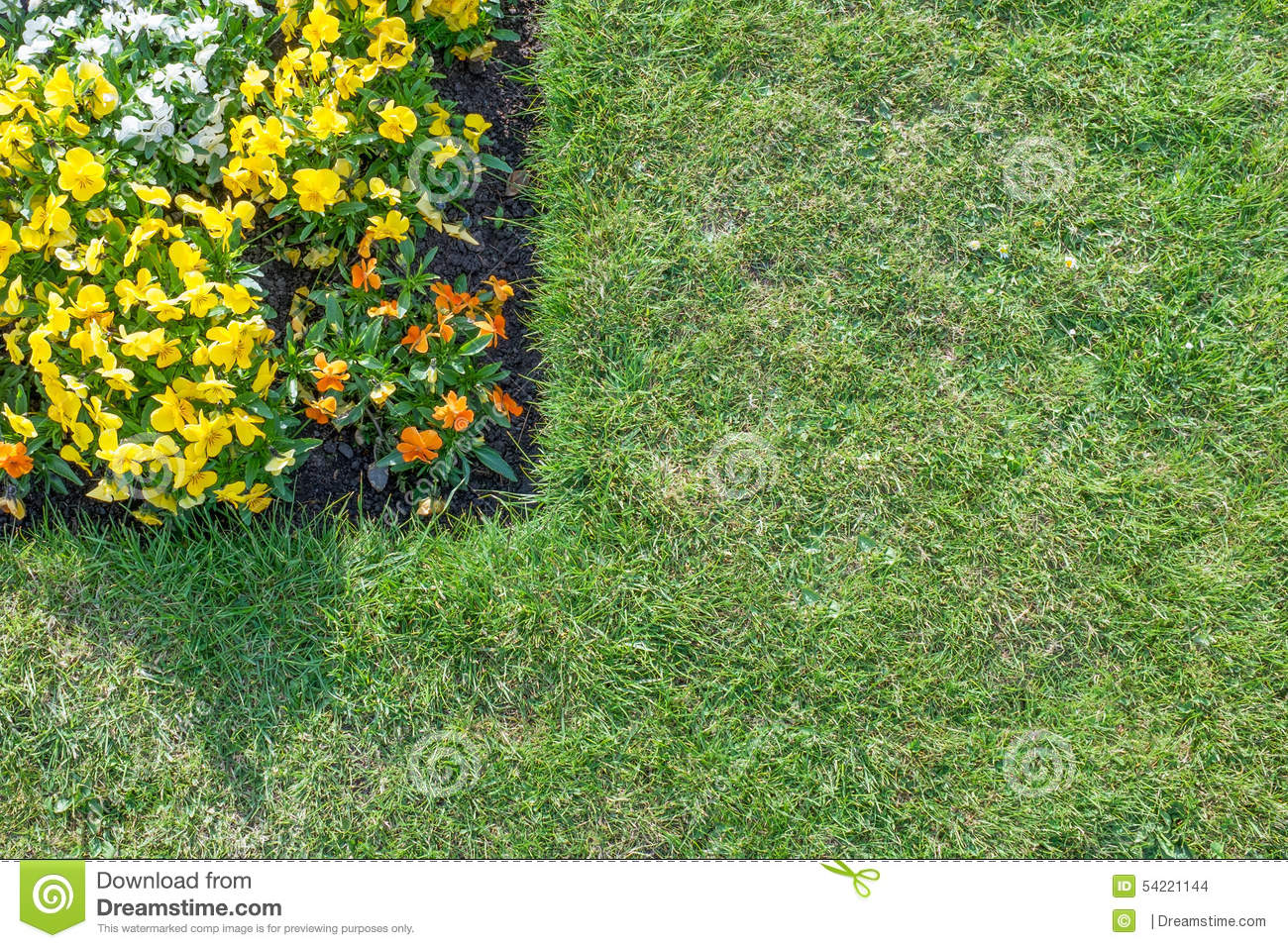Flower Bed With Orange Yellow White Flowers Surrounded By Gre