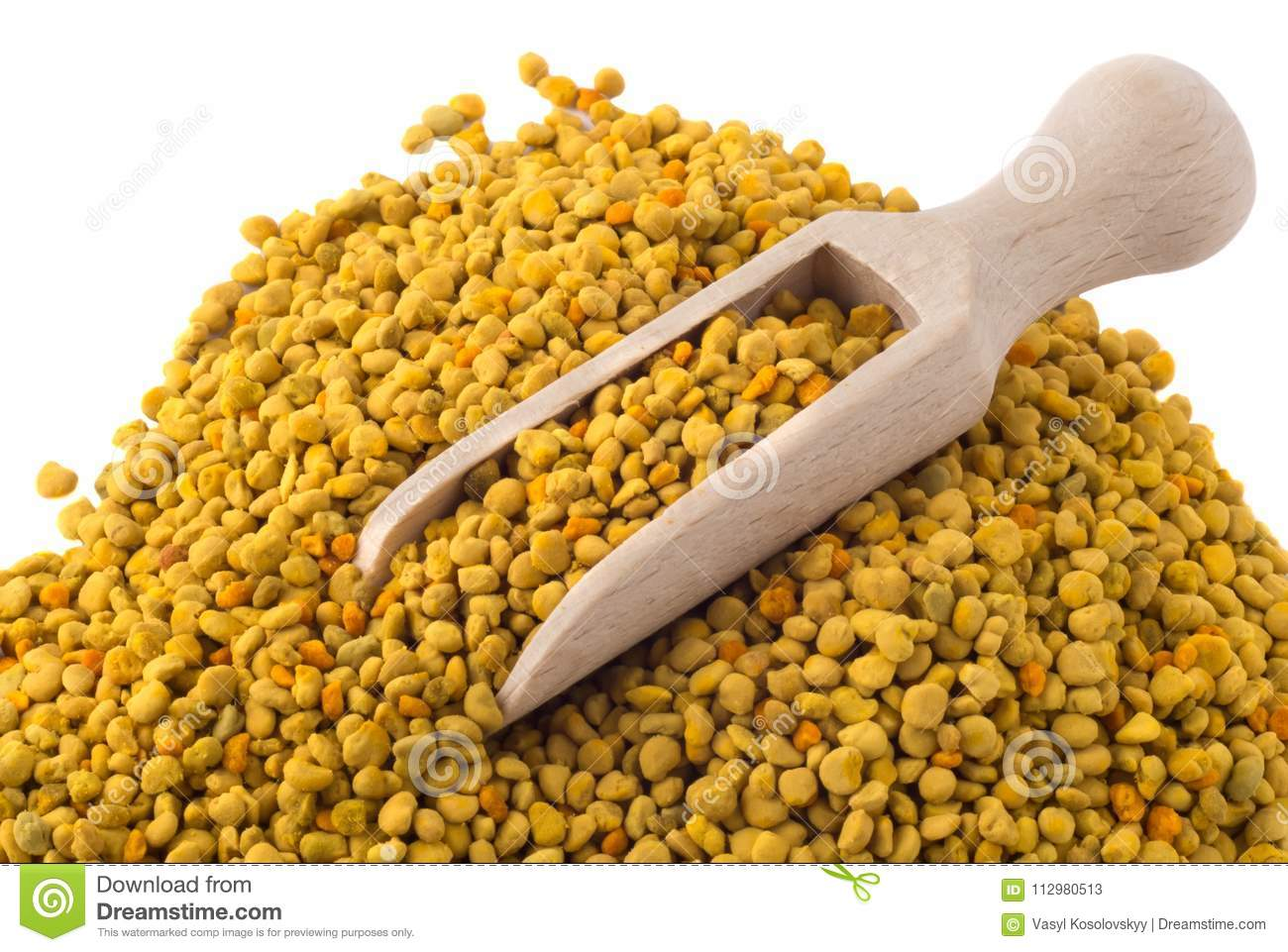 Flower bee pollen and a wooden slove is isolated on a white background. Beekeeping products. Apitherapy.