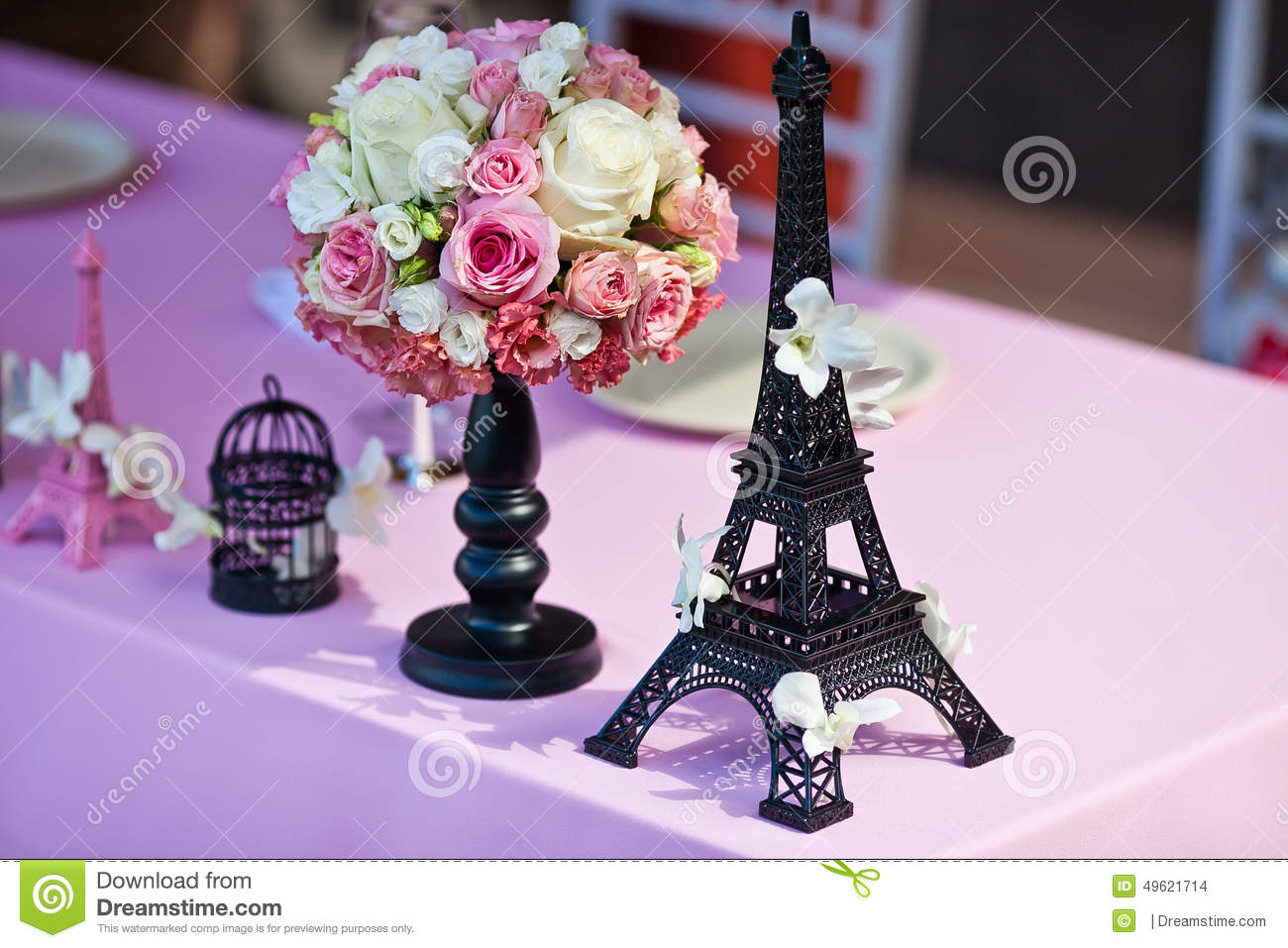 Flower bouquet with eiffel tower on a wedding table stock photo flower bouquet with eiffel tower on a wedding table mightylinksfo Gallery
