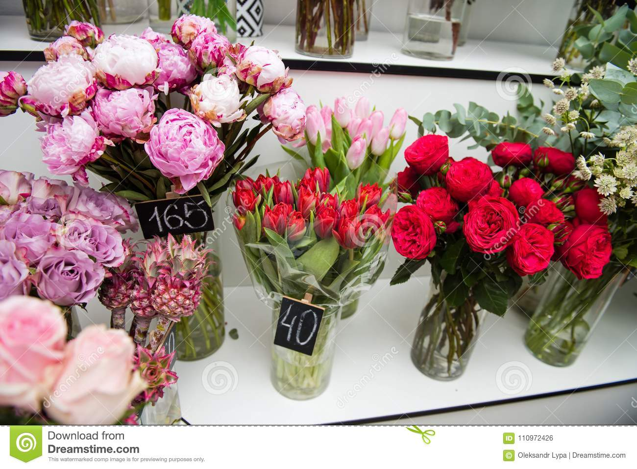 Colorful Flowers In Vases At Store Indoors Stock Photo - Image of ...