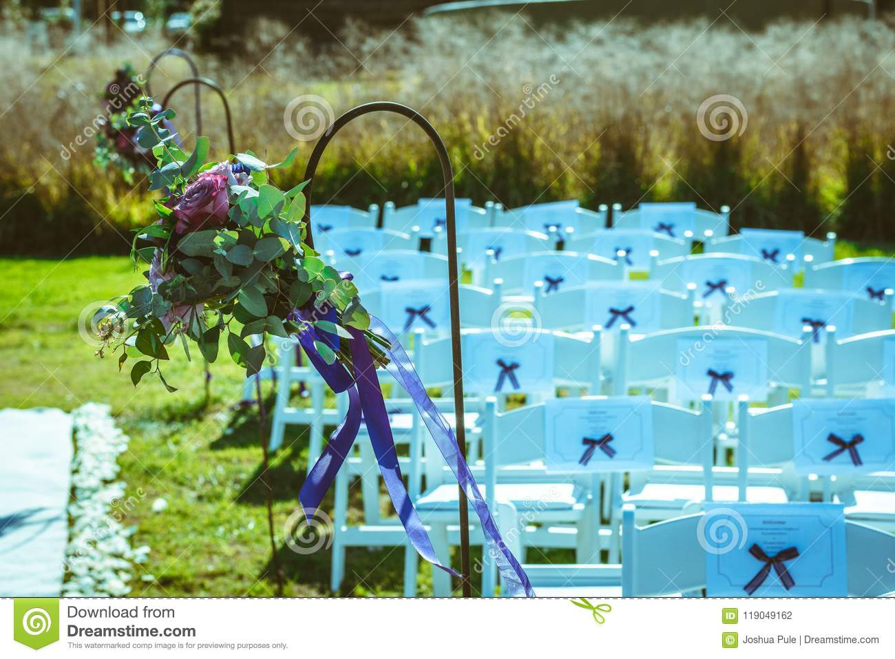 Hinged Flowers Decorating The Pathway Outdoor Wedding Stock Photo