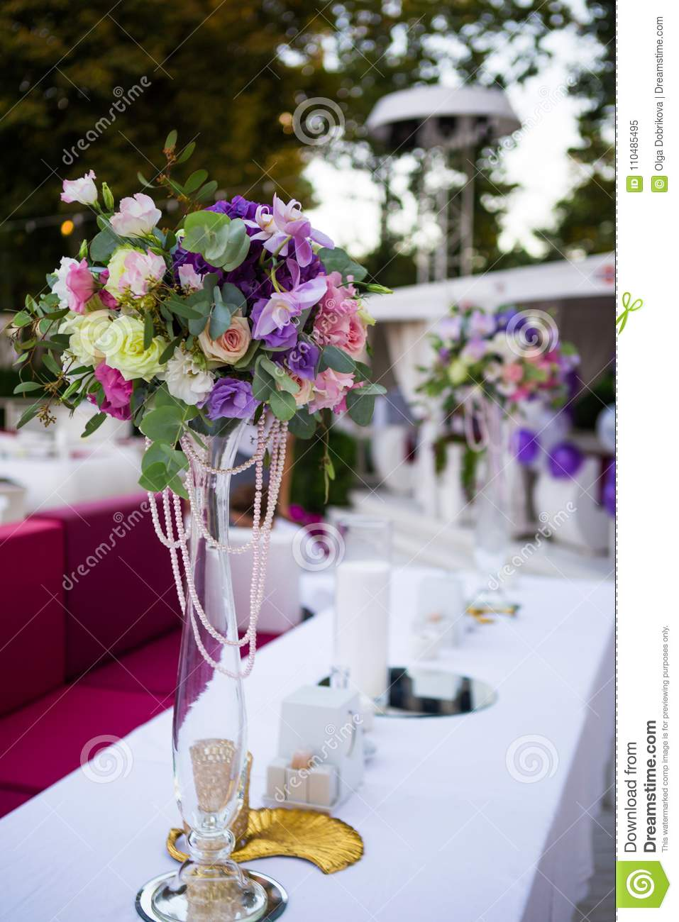 Flower decoration on festive table in open air cafe stock image flower decoration on festive table in open air cafe beautiful wedding decorations festive table with flowers in vase junglespirit Image collections