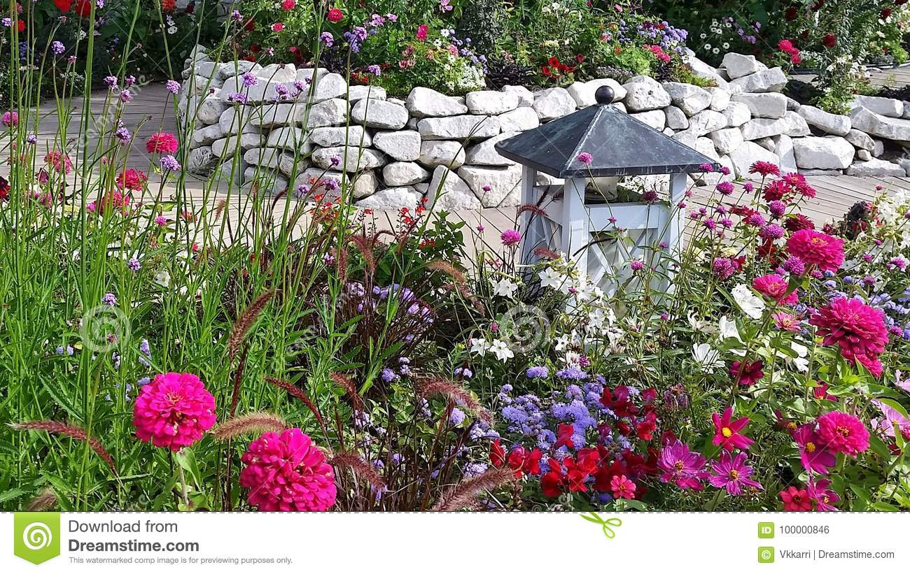 english flower garden with lantern stock photo - image of pink