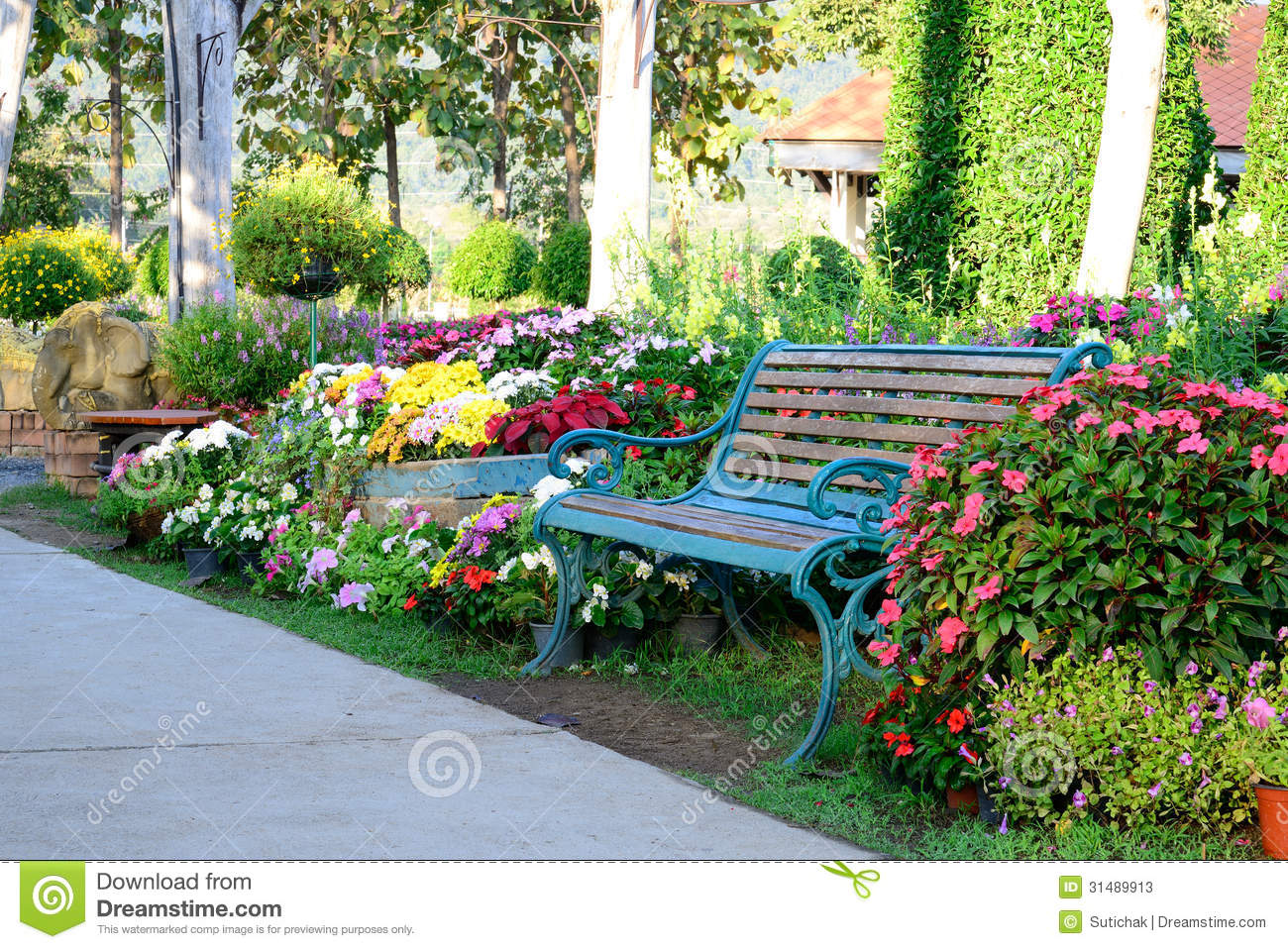 Flower Garden And Vintage Bench Stock Image - Image: 31489913