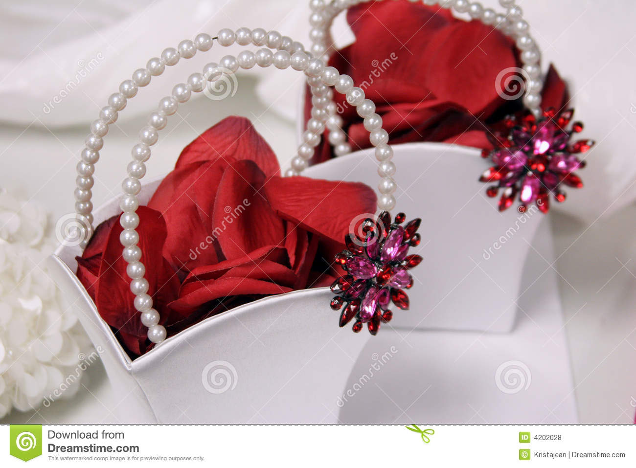 Flower girl baskets stock photo image of petals brooch 4202028 white flower girl baskets filled with rose petals mightylinksfo