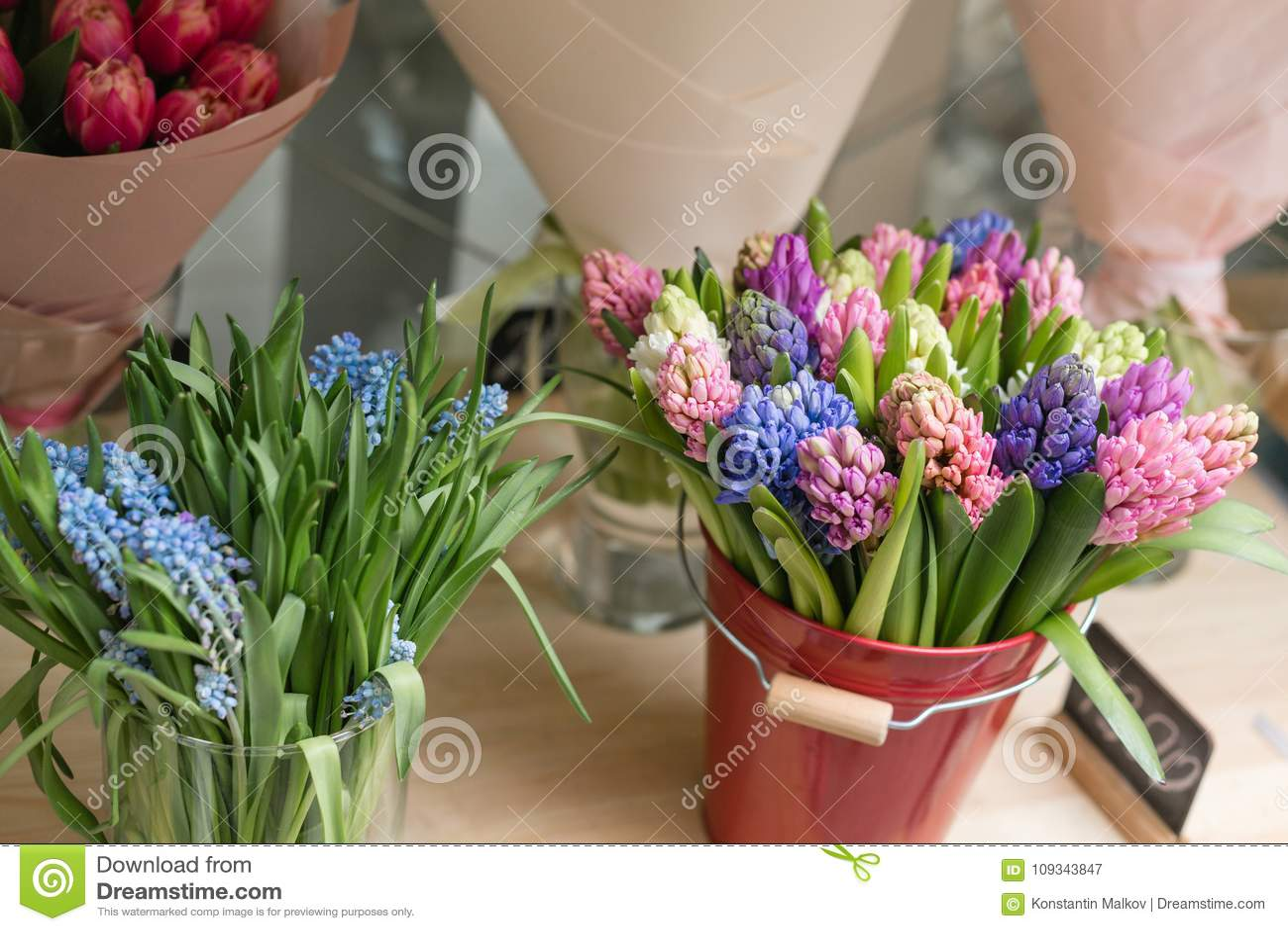 Flower shop concept different varieties fresh spring flowers in flower shop concept different varieties fresh spring flowers in refrigerator for flowers bouquets on shelf florist business mightylinksfo