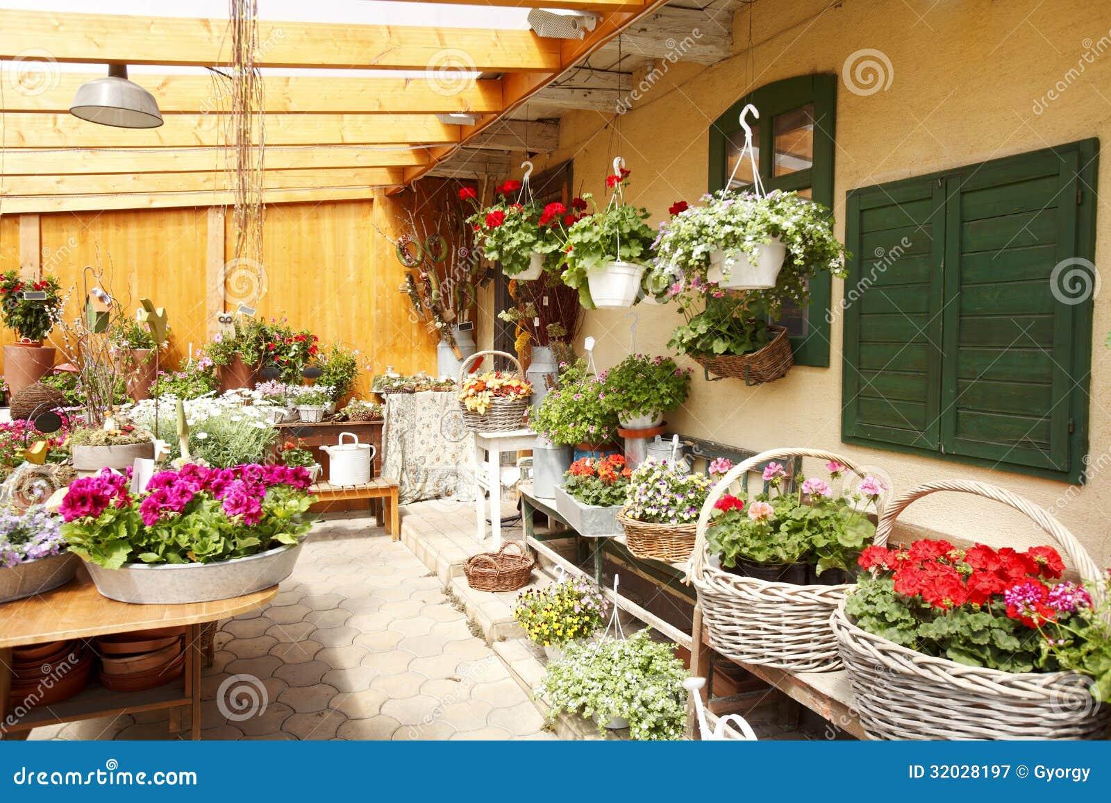 http://thumbs.dreamstime.com/z/flower-shop-interior-flowers-merchant-small-business-32028197.jpg