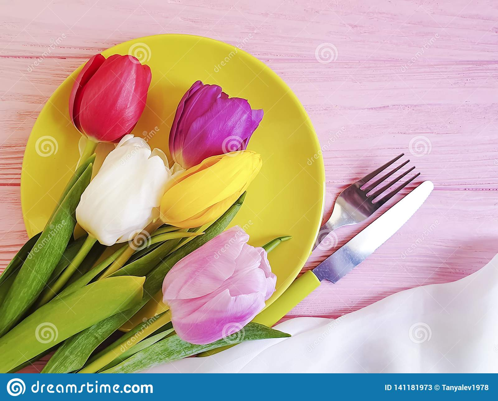Flower tulip blooming , a plate on a pink wooden romantic background, birthday