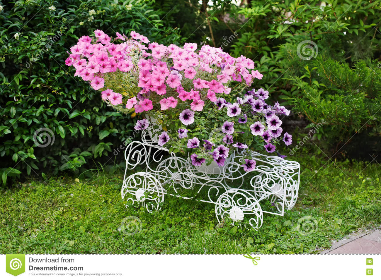 Flowerbed Cart With Bright Pink Flowers. Stock Photo - Image of ...