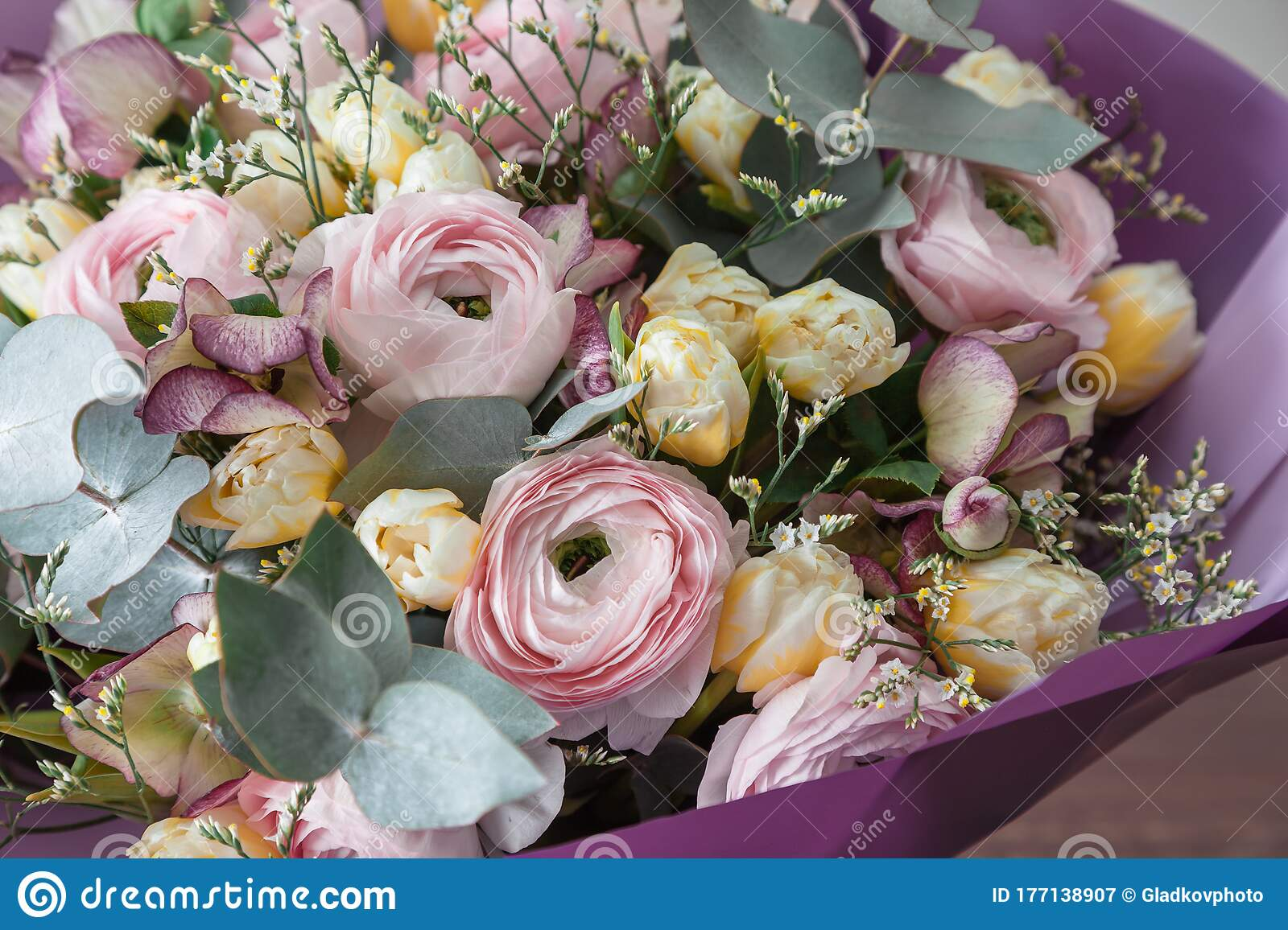 Flowers In Bouquet Close Up Pink Ranunculus And Yellow Tulips Eucalyptus Leaves Stock Image Image Of Flora Color 177138907