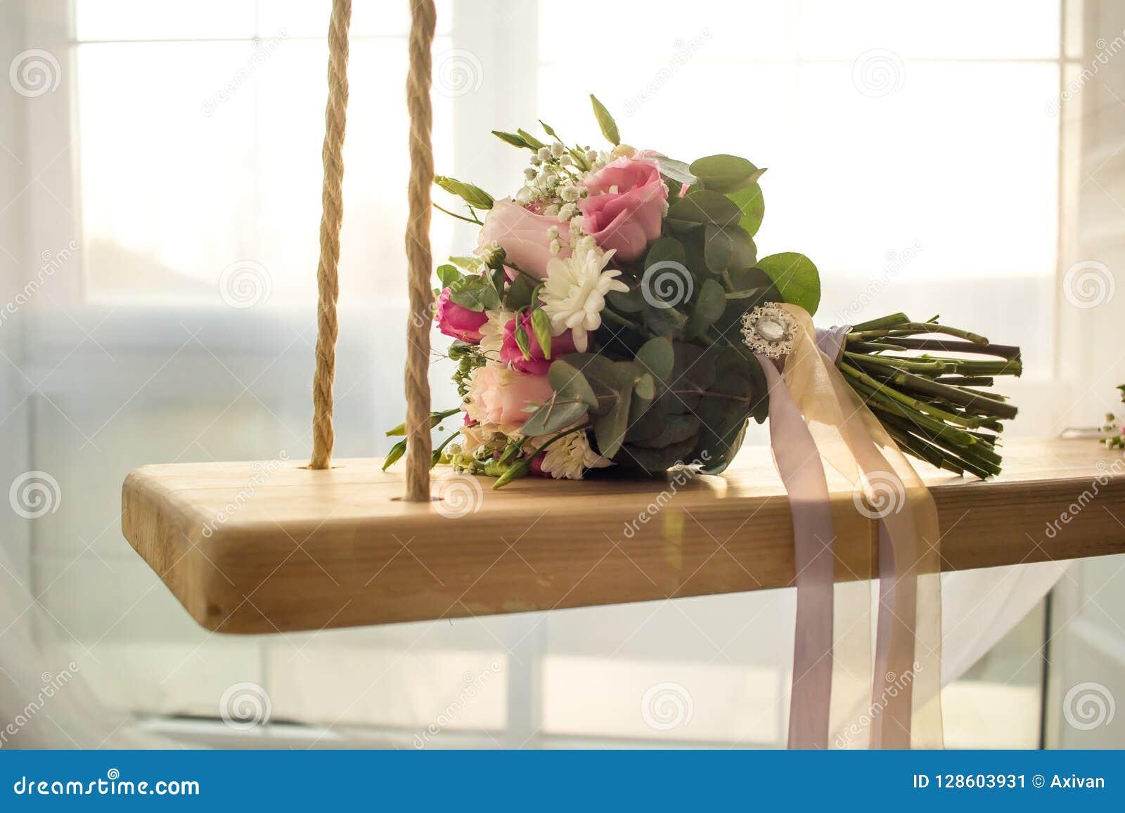 Flowers Bouquet On Indoor Swing With Window Wedding