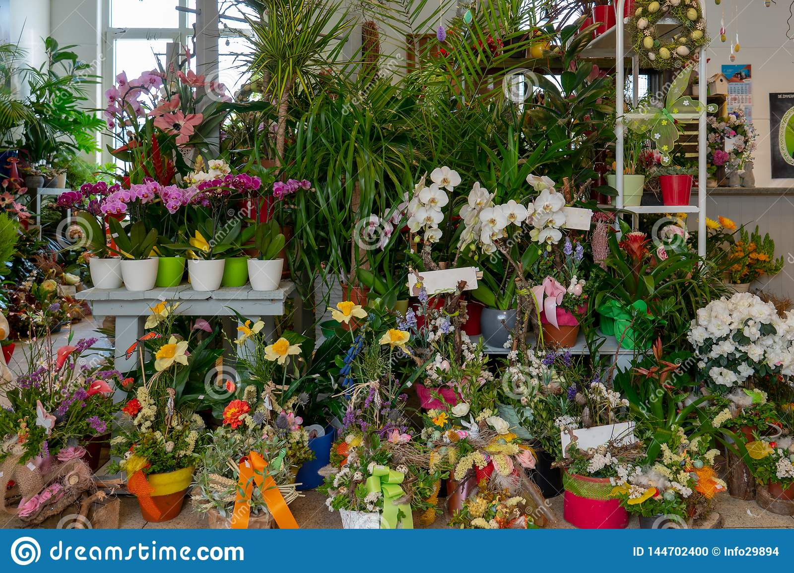 flowers and bouquets stand in a florist`s shop