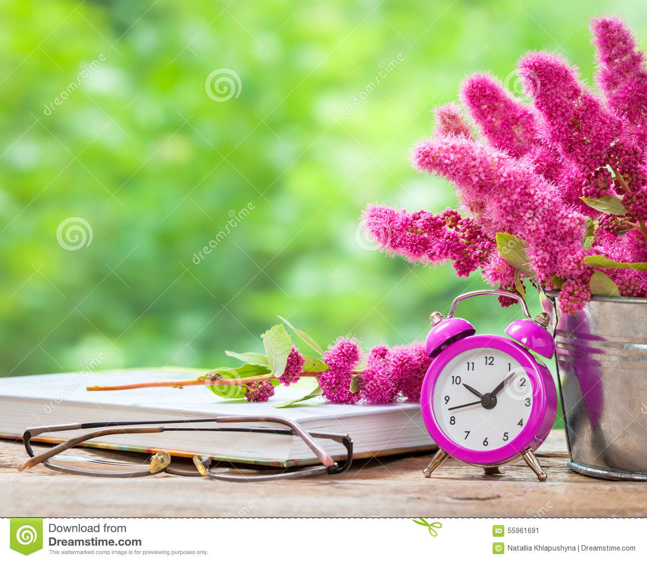 Flowers In Bucket Pink Alarm Clock And Book Stock Photo