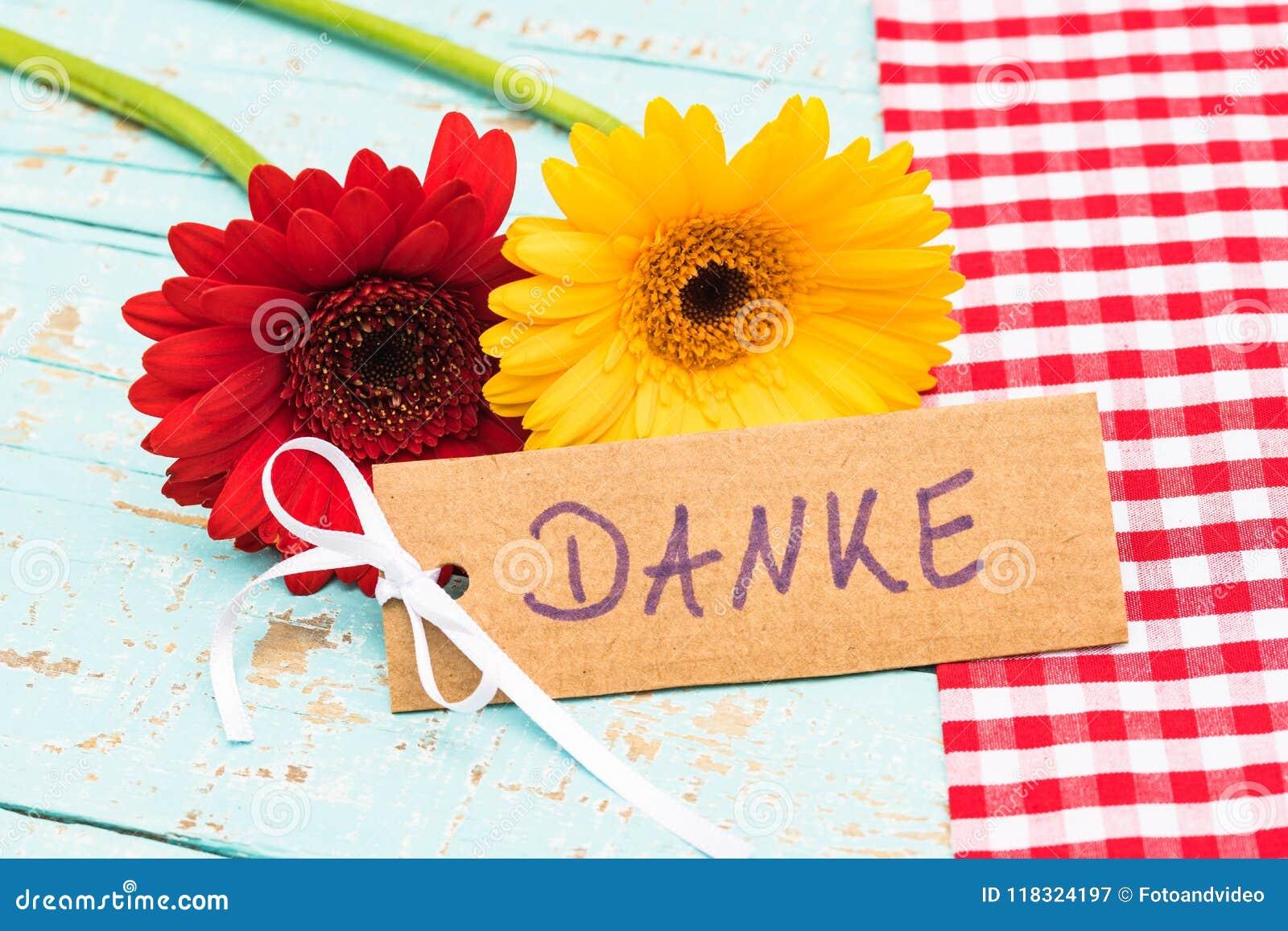 Beautiful Gerbera Flowers And Card With German Word Danke Means