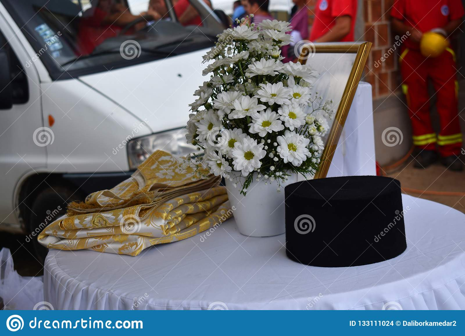 Flowers, cloths and caps of priests.