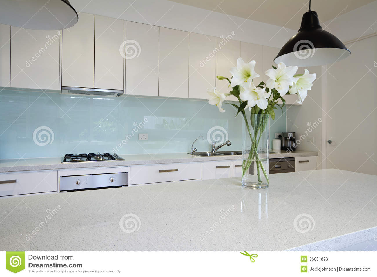 Flowers On Contemporary Kitchen Bench Stock Photos