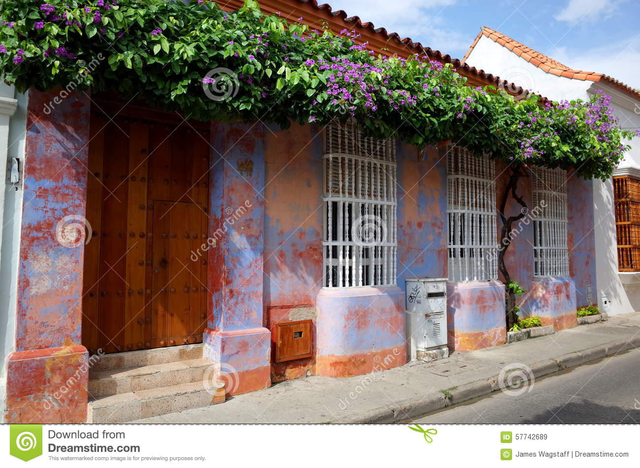 Flowers Decorate A Purple Colonial House In Cartagena