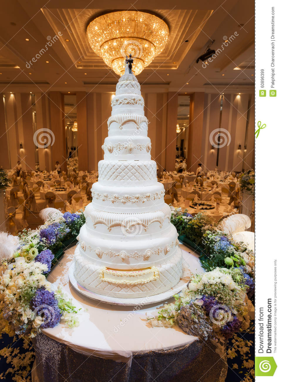 Flowers And Decorations Around Wedding Cake With Chandelier On C – Cake Chandelier