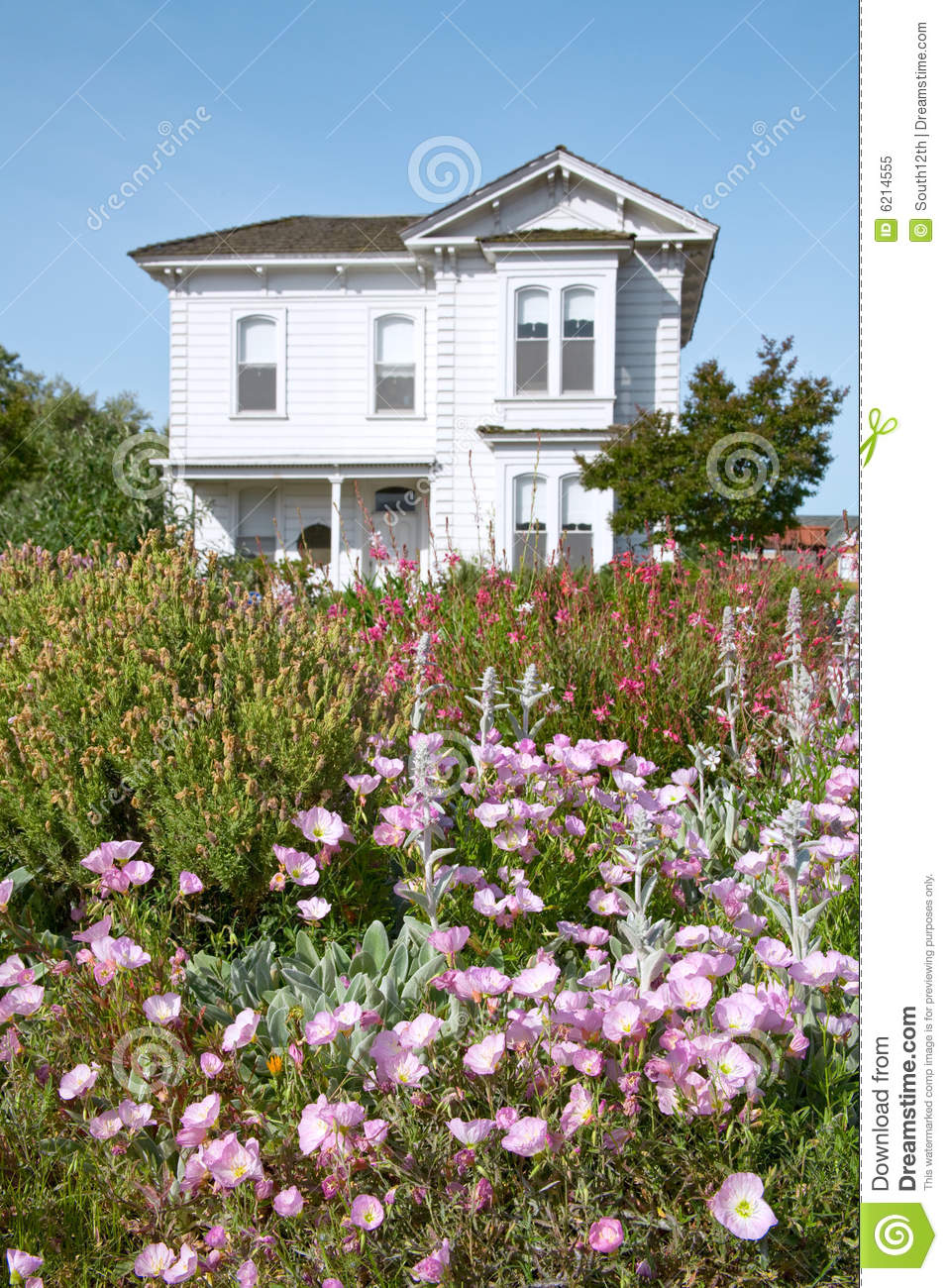Flowers In Front Old Victorian Farmhouse Royalty Free Stock Image