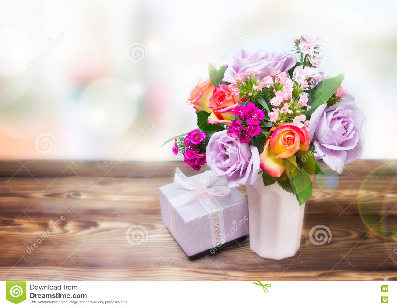 Flowers gift box on table empty space background stock photo flowers gift box on table empty space background reviewsmspy