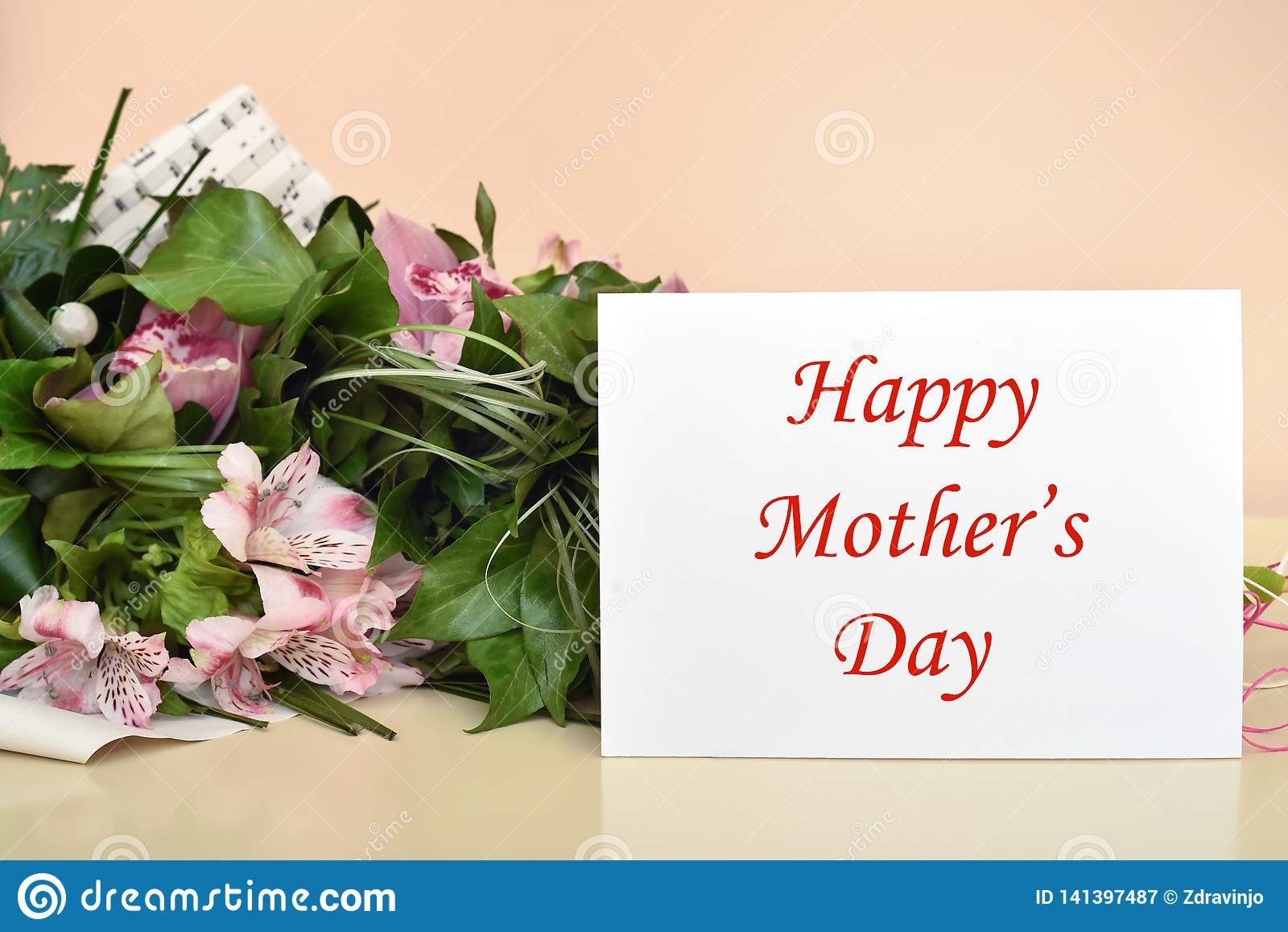 Flowers and greeting card with Happy Mother's Day message