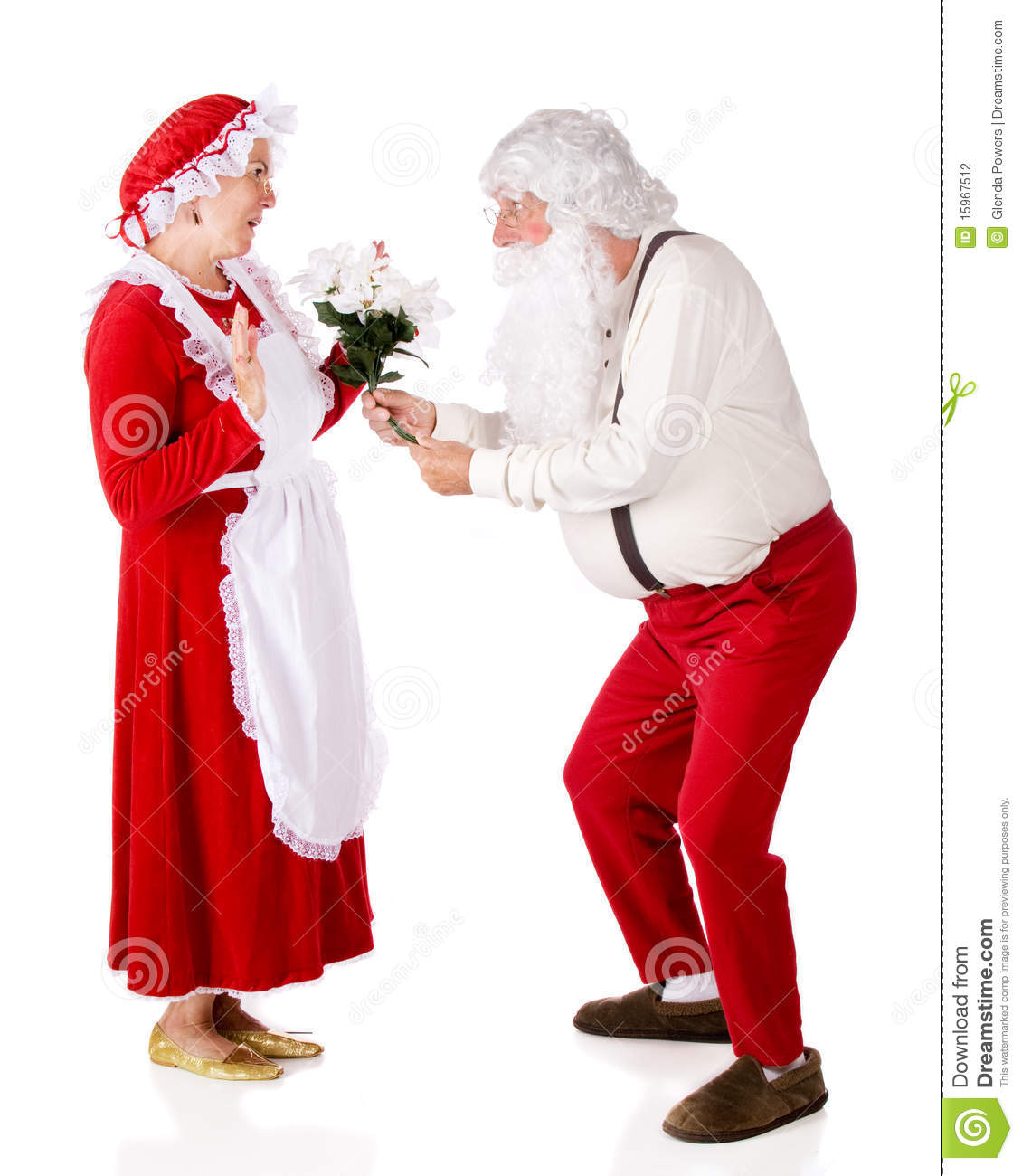 Mrs clause giving santa his present