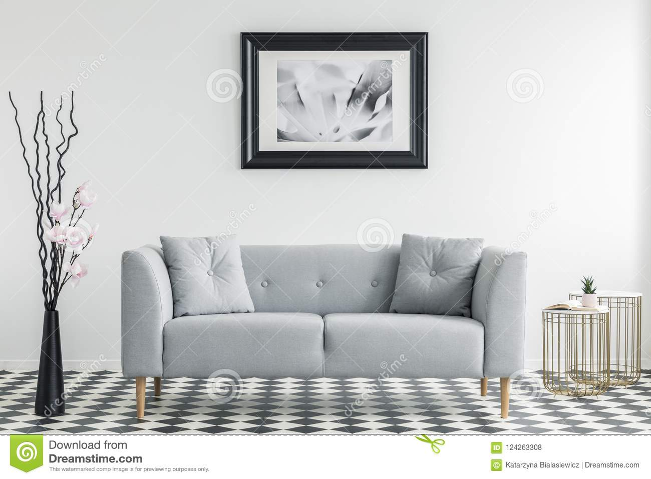 Download Flowers Next To Grey Sofa With Cushions In Minimal Living Room I  Stock Photo