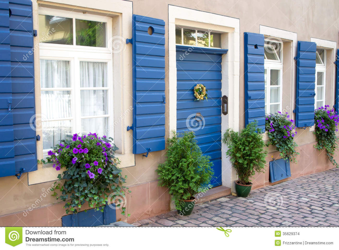 Flowers and plants decorating house exterior stock photo for Outer decoration of house