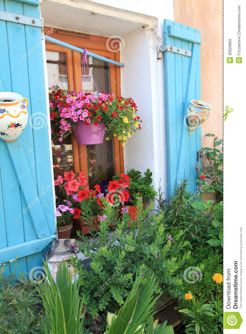 Flowers and plants decorating house exterior stock photos - How to decorate my home ...