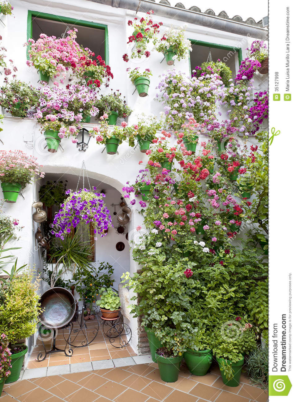 flowers pots standing in a andalusian patio royalty free. Black Bedroom Furniture Sets. Home Design Ideas