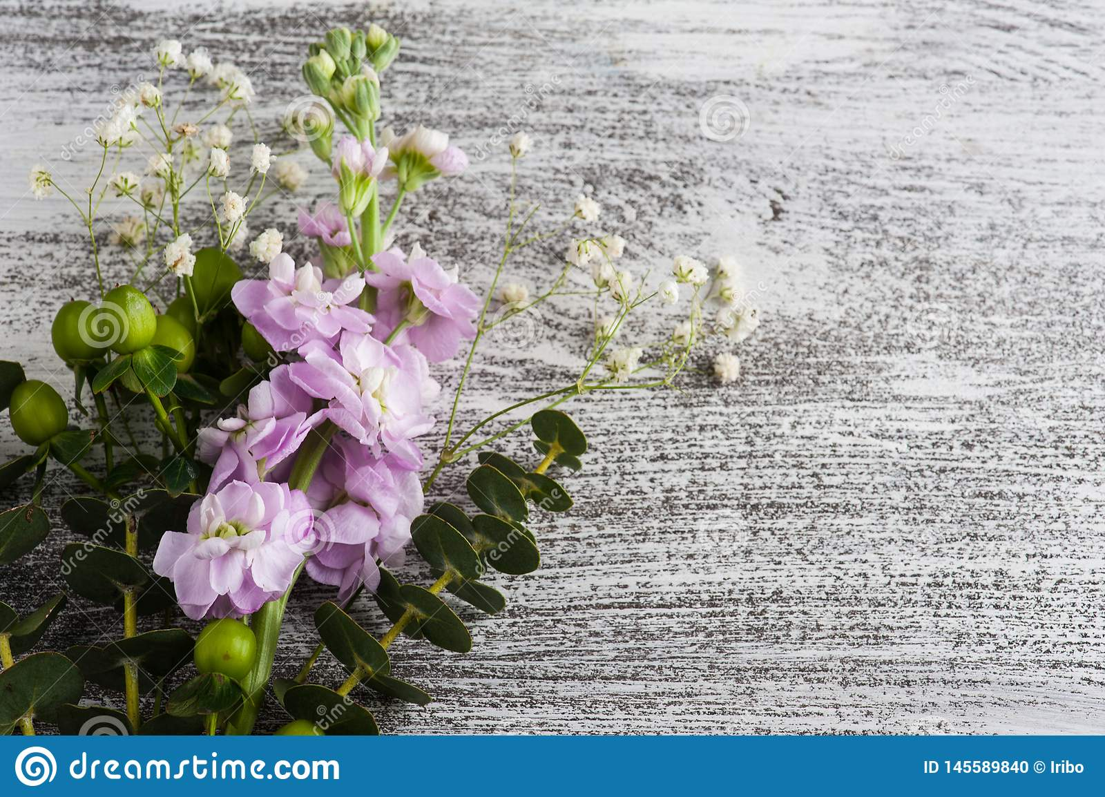 Flowers on rustic wooden background
