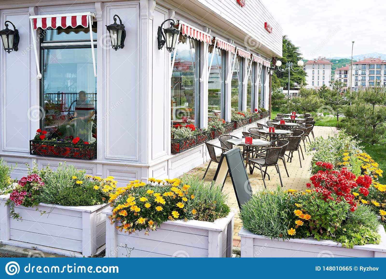 Flowers and tables of outdoor summer cafe