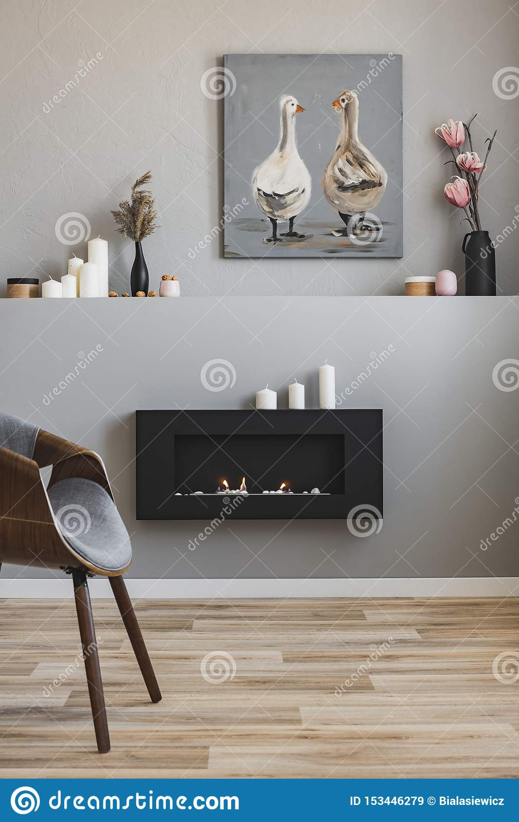 Flowers In Vases Candles And Rustic Painting On Shelf Above Eco Fireplace In Fashionable Living Room Interior Stock Image Image Of Fireplace Elegant 153446279