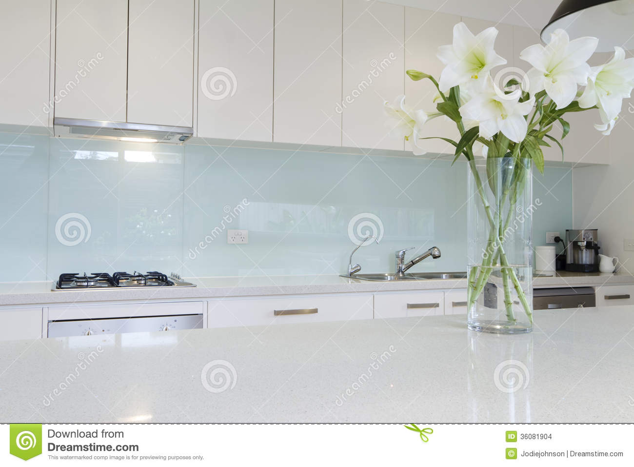 Flowers On White Kitchen Bench Stock Photo - Image of detail, decor ...