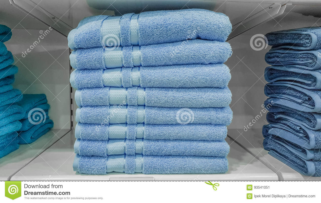 Fluffy Bathing Towels In Blue Colors Stacked On Shelf For Sale In A ...