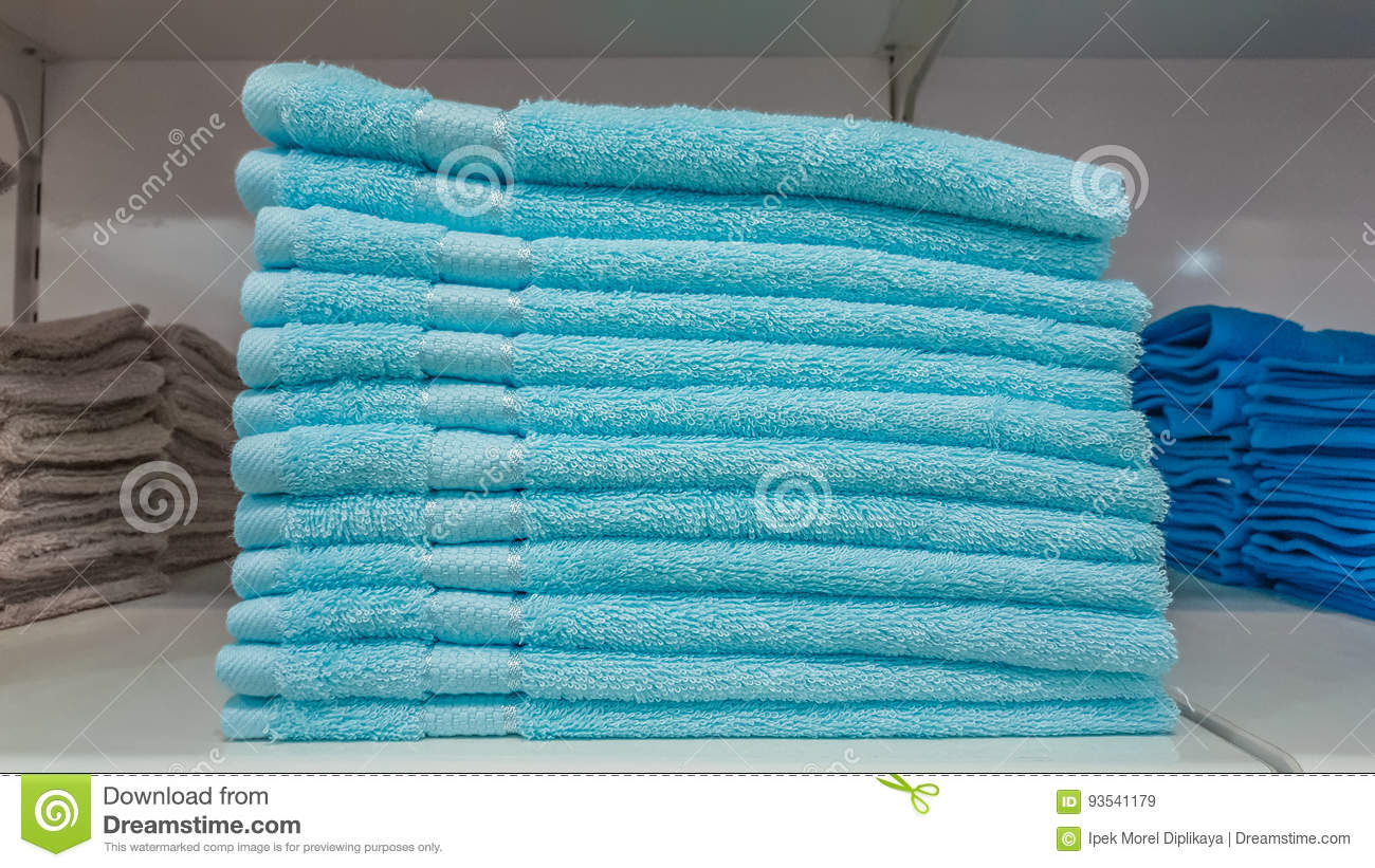 Fluffy Bathing Towels In Blue And Cyan Colors Stacked On Shelf For ...