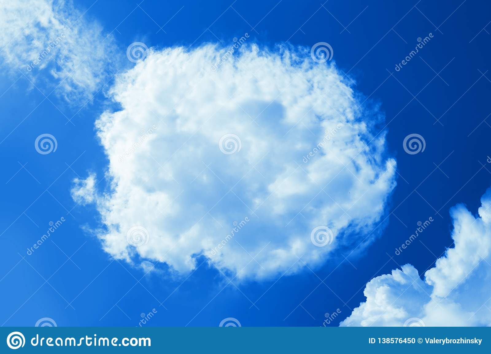 Fluffy round cloud in clear blue sky. Peaceful cloudy sky natural background, frame. Sunny day, light. Divine shining background