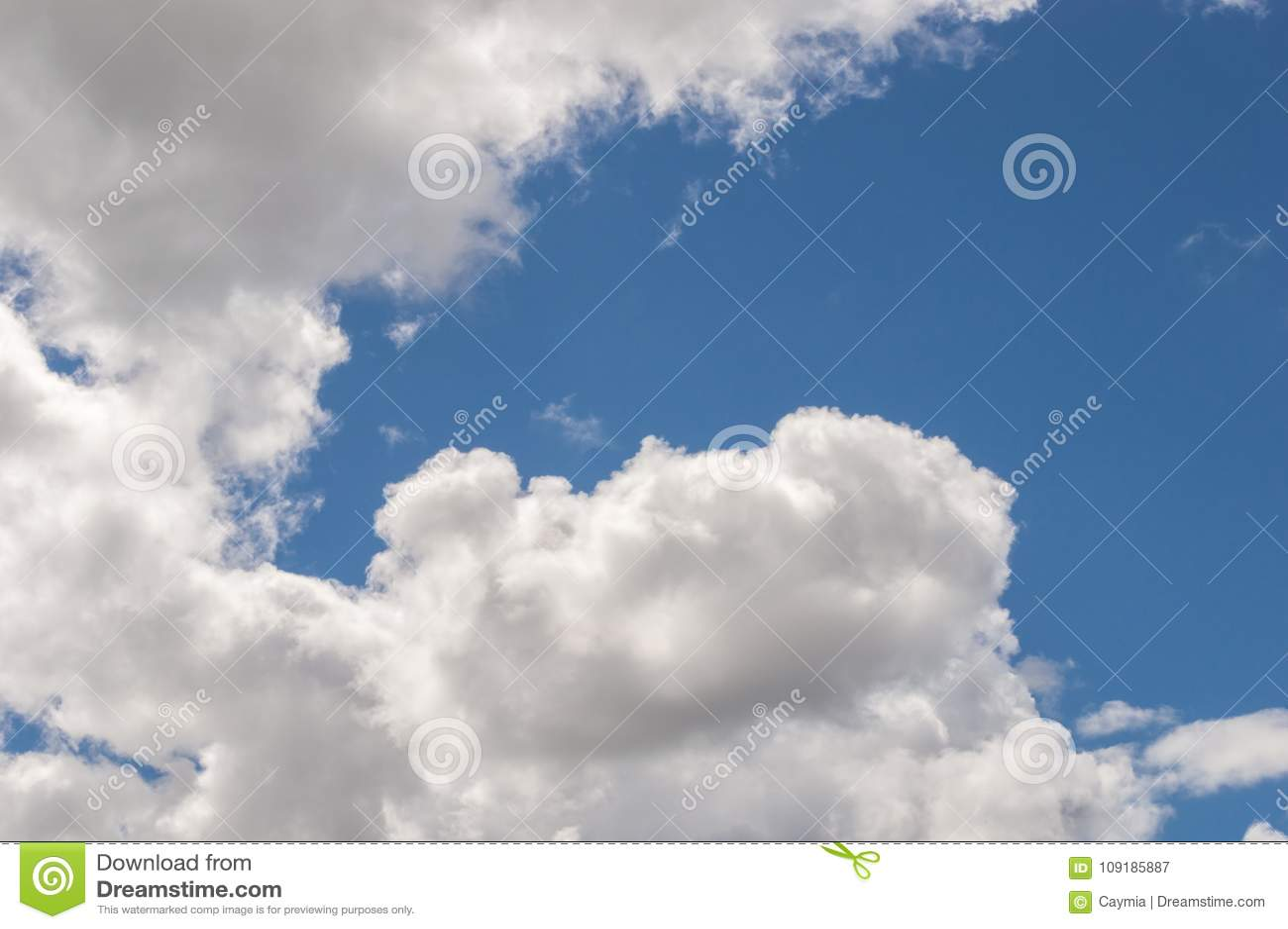 billowy  Fluffy White Billowy Clouds Brightly Back Lit, Blue Sky. Stock Image ...