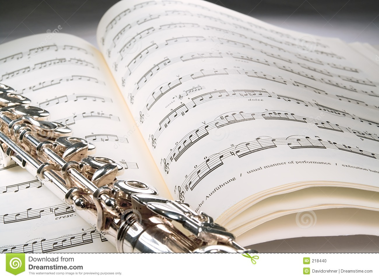 flute on an open musical score with gray background stock
