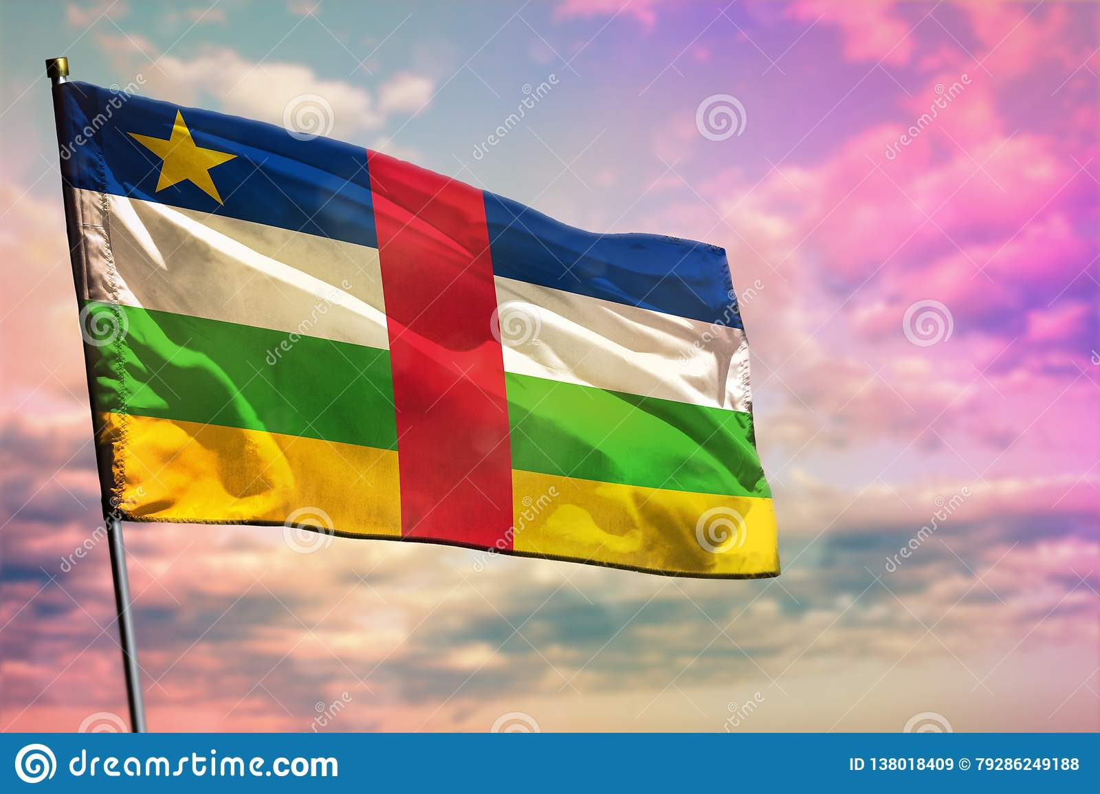Fluttering Central African Republic flag on colorful cloudy sky background. Prosperity concept