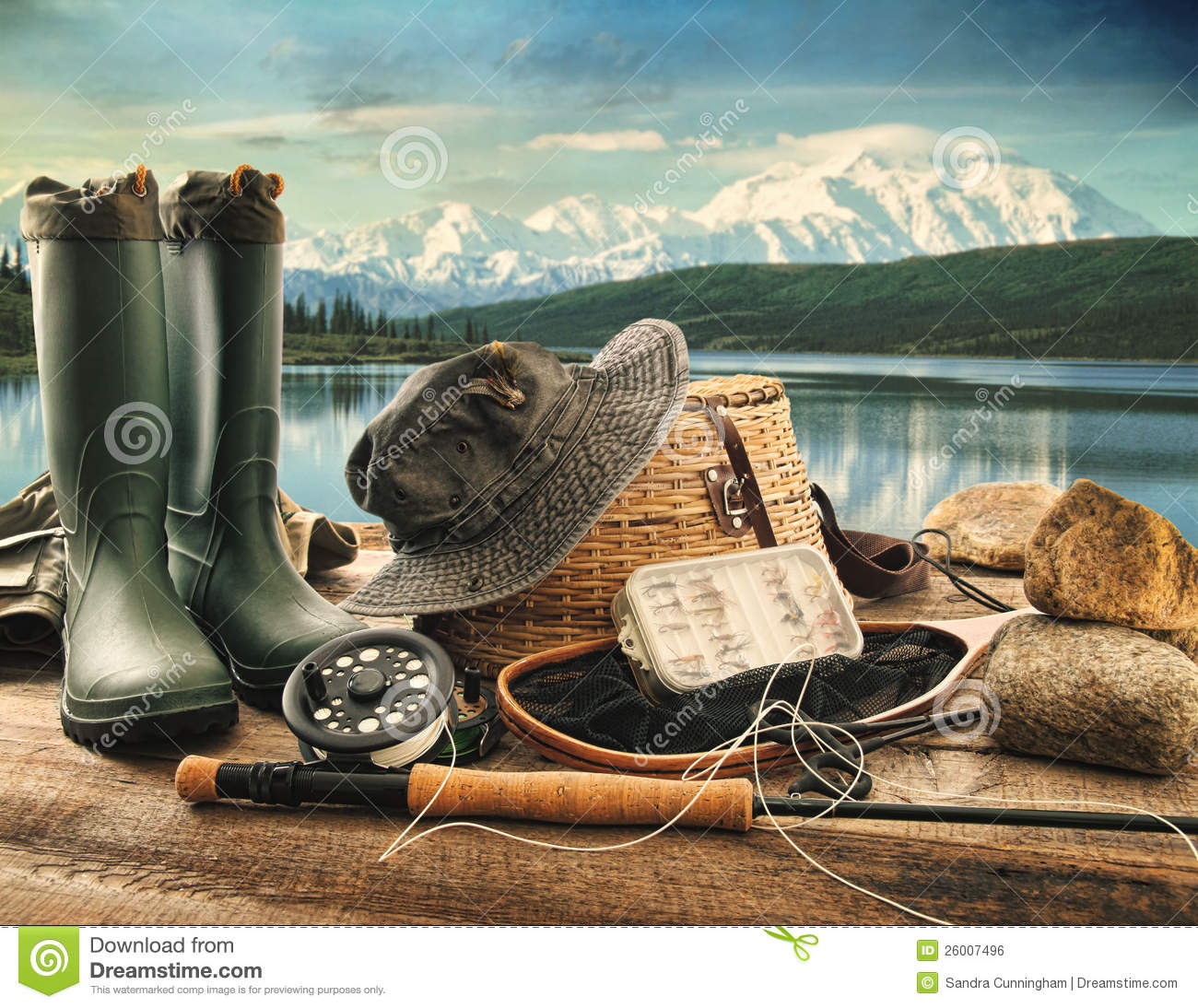 Fly fishing equipment on deck of mountains