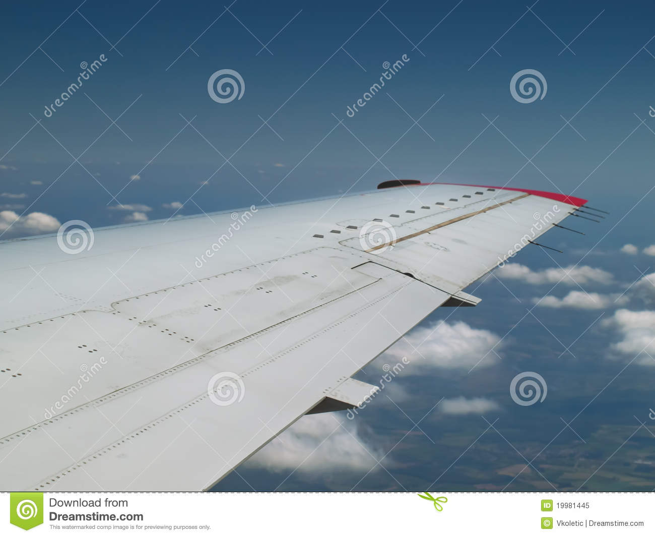 Airplane wing when flying high over the clouds for traveling themes